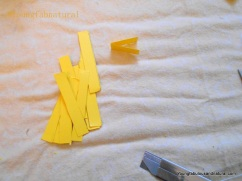 Fold one of the strips in half again