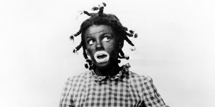 American actress and singer Judy Garland (1922 - 1969) in blackface as Judy Bellaire in 'Everybody Sing', 1938. (Photo by Silver Screen Collection/Getty Images)